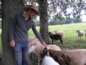 Nathan Moomaw with his flock of sheep at Moomaw Family Farm, Molalla
